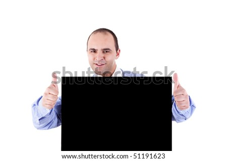 Young businessman holding a blackboard displaying the sign of success, isolated on white background