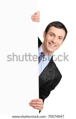 Young businessman holding a blank billboard isolated on white background