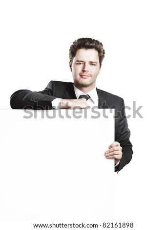 Young businessman holding a blank white board. Isolated on a white background