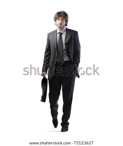 Young businessman holding a briefcase