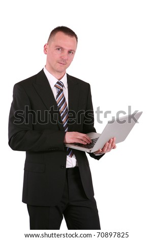 Young businessman holding a laptop, isolated on white