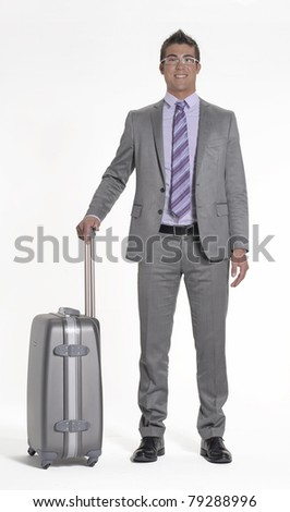 Young businessman holding a luggage on white background. Young traveler businessman on white background.