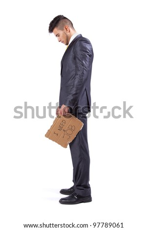 Young businessman holding a piece of cardboard saying he needs a job