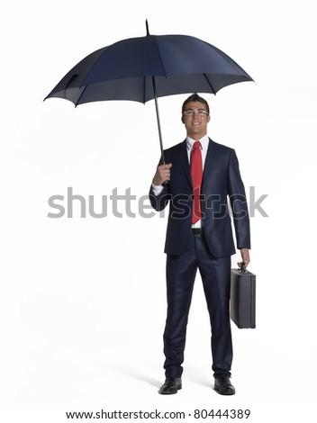 Young businessman holding an umbrella.