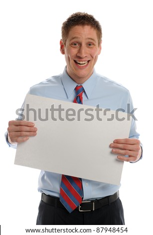 Young Businessman holding blank sign and expressing excitement isolated on a white background