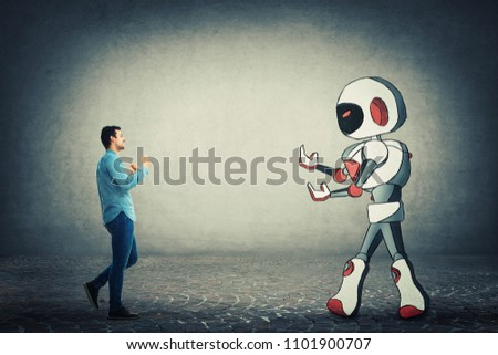 Young businessman holding fists ready to fight against robot. Rivalry between human and technology. Danger of losing the job, replacing the human work force with the robotic. Artificial intelligence. #1101900707