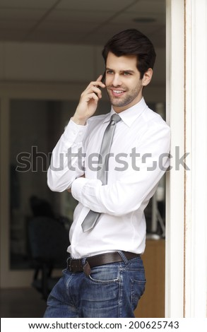Young businessman holding handy in his hand. Small business.