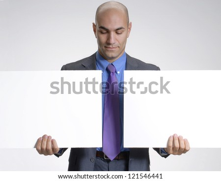 Young businessman holding two white panels.