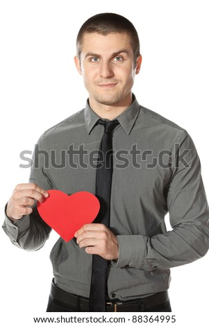 Young  businessman holds a heart shape, isolated on white