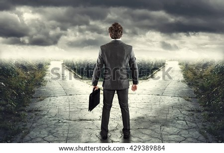 Young businessman in front of a bifurcation - Which path? Stockfoto ©
