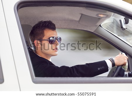 young businessman in his car - stock photo