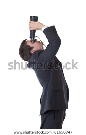 Young businessman in profile looks through binoculars. Isolated on white background.
