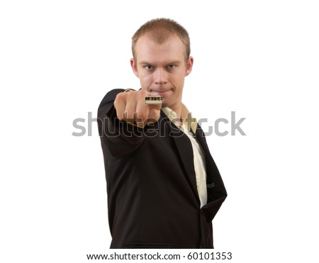 Young businessman in suit pointing in you with USB on his finger, isolated on white