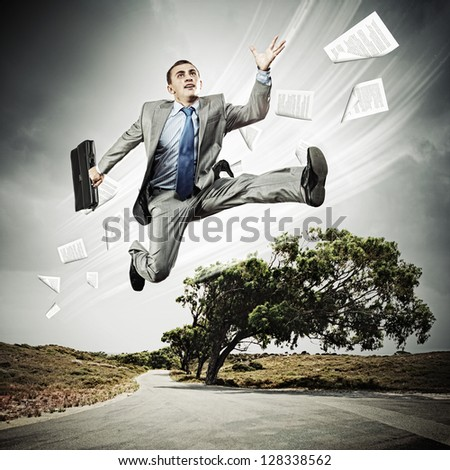 Young businessman in suit running on the road