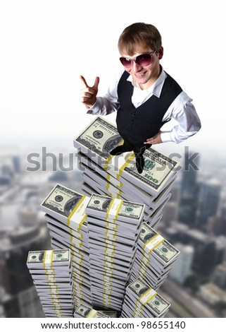 Young businessman in sun glasses with money