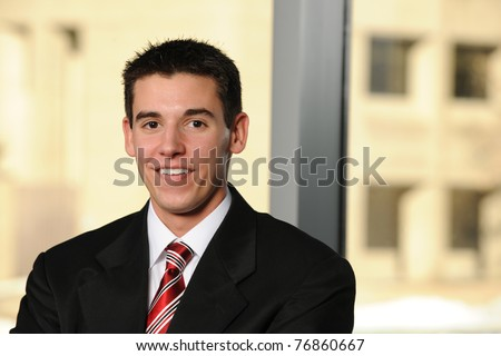 Young Businessman inside an office building