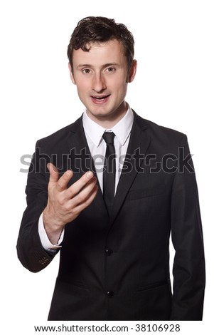 young businessman is talking and adressing the viewer of this picture