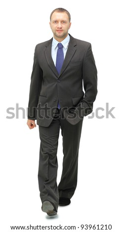 young businessman is walking. He is smiling and looking to the camera. isolated over white background