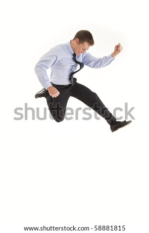 Young businessman jumping in the air with excitement - stock photo