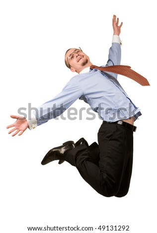 Young businessman jumping into the air over white