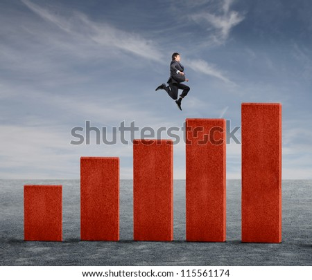Young businessman jumping on a business analysis