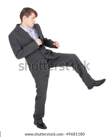 Young businessman kicks as karate, isolated on a white background