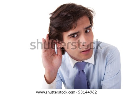 Young businessman, listening, viewing the  gesture of hand behind the ear, isolated on white background. studio shot