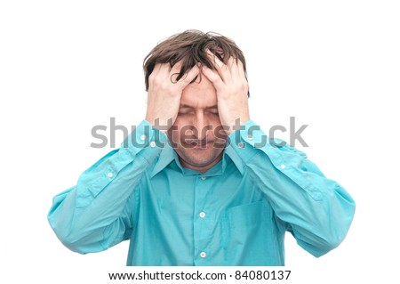 Young businessman looking anxious and worried, having a headache - stock photo