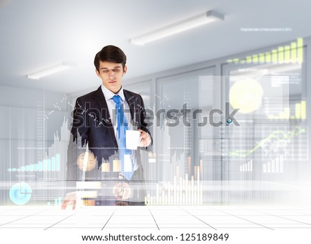 young businessman looking at graph of high-tech image
