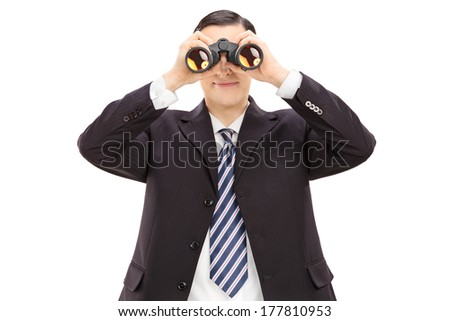 Young businessman looking through binoculars isolated on white background