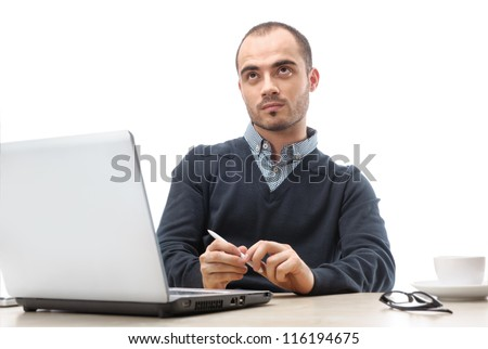 Young businessman looking up at office