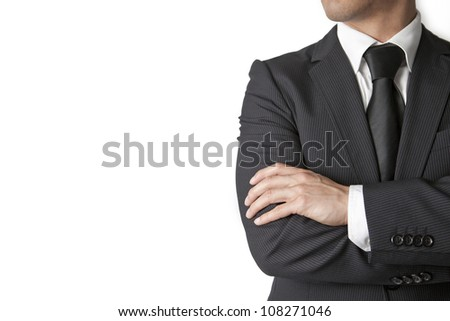 Shutterstock Young businessman looks away on white background