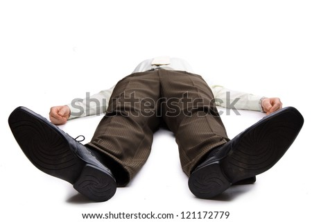Young businessman lying on the floor