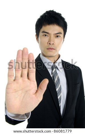 Young businessman making stop with his hand-close up