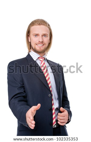 Young businessman offering a handshake, isolated on white