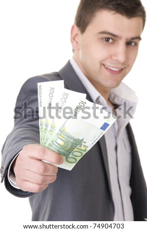 Young Businessman Offering Money - stock photo