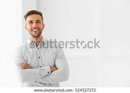 Shutterstock Young businessman on light background