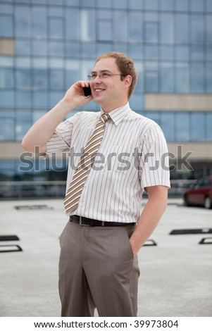 Young businessman on the phone (outdoor the office)