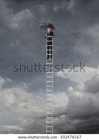 Young businessman on the top of a ladder with an umbrella and stormy sky in the background