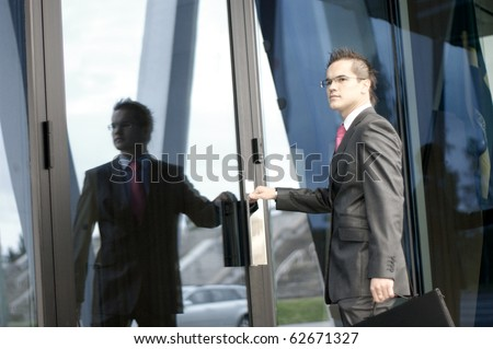 young businessman over modern background