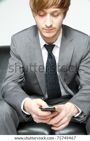 young businessman playing with his cell