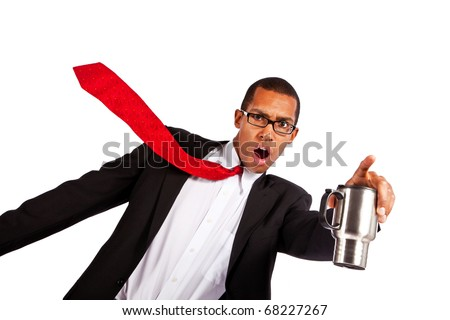 Young businessman points while holding coffee mug.