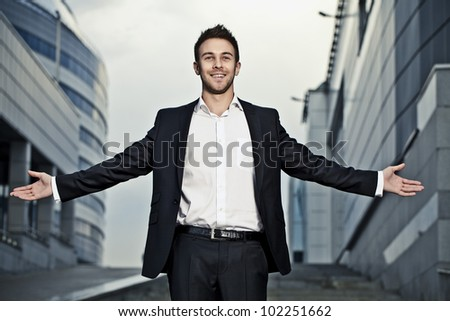 Young businessman pose outdoor.