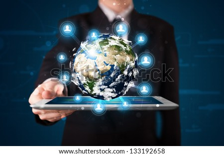 Young businessman presenting 3d earth globe in tablet elements of this image furnished by NASA