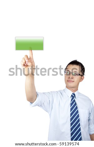 Young businessman pushing an empty green button on a touch screen.