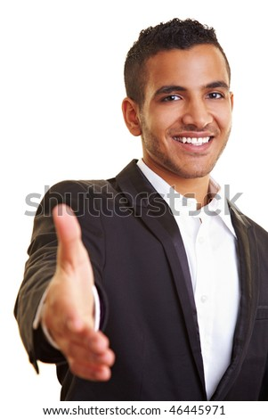 Young businessman reaching out for a handshake