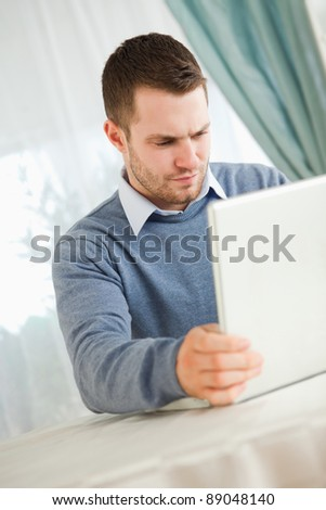 Young businessman reading on his laptop