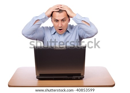 Young businessman reading shocking news on the laptop