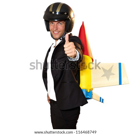 young businessman ready to climb with rocket on his back - isolated on white with clipping path