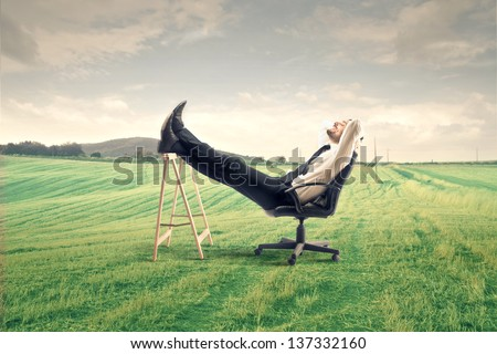 young businessman relaxes sitting outdoor
